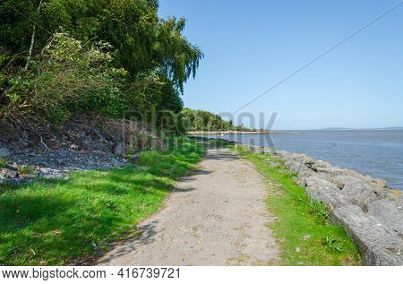 High Tide At Flint Foreshore On The River Dee In North Wales Following The Route Of The North Wales
