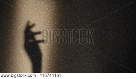 Shadow Of Silhouette Of Female Hand On Gray Background. Elegant Female Hand Shadow In Sunbeam With C