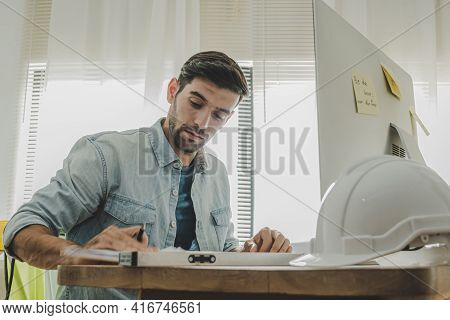 Young Caucasian Engineer, Architect, Contractor Thinking Working About New Project Contract Plan Wit