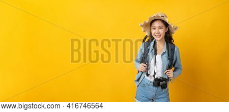 Asian Woman Hipster Traveler With Camera, Backpack And Hat In Casual Clothing Happy And Smiling Over
