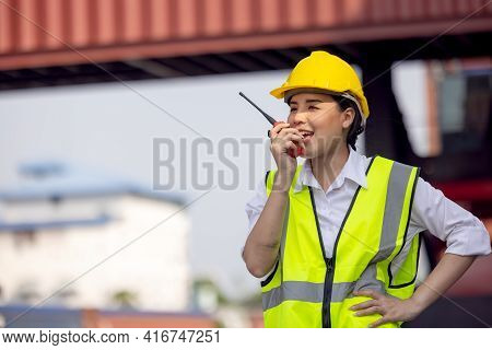 Woman Factory Worker Or Engineer Using Walkie Talkie And Calling Someone For Preparing A Job In Cont