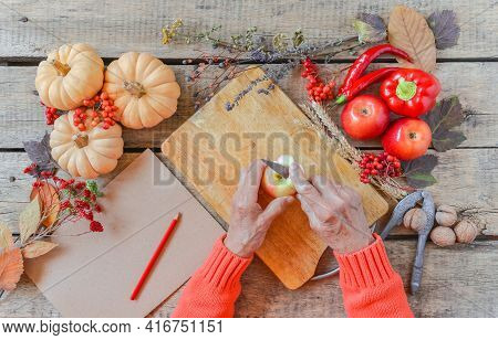 Senior Woman Hands Cutting Vegetables, Cooking Process, Family Tradition. Autumn Background, Fallen