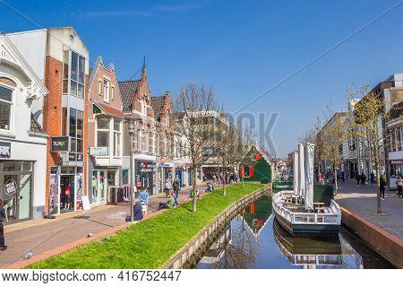Zaandam, Netherlands - March 31, 2021: Boat In The Canal Of The Shopping Street In Zaandam, Netherla