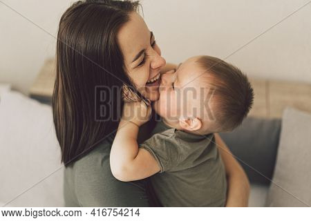 Happy Loving Family. Mom And His Son Are Hug At Home. Mother's Day.