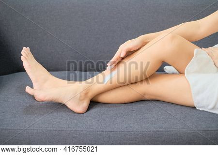 Woman Applying Natural Cream, Woman Moisturizing Her Leg With Cosmetic Cream With Copy Space.