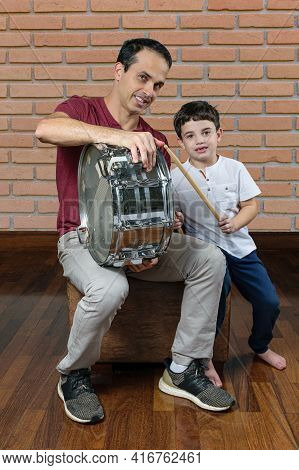 Father (44 Years Old) Teaching His Son (7 Years Old) The First Drum Lessons, Photo 1. Brick Wall Bac