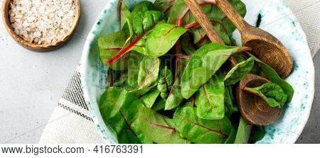 Fresh Swiss Chard Leaves Or Mangold In Ceramic Dish On Grey Light Concrete Background. Concept For T