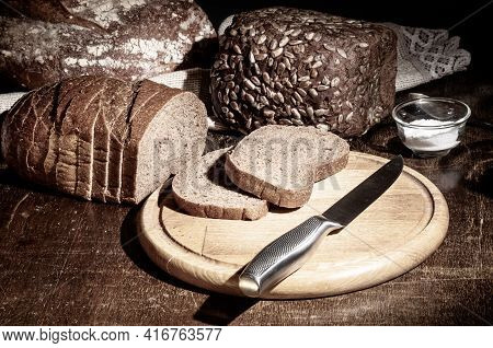 Still Life - Yeast-free Buckwheat Bread, Various Types Of Black Bread, With Olive Oil And Coarse Sal