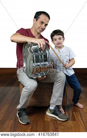 Father (44 Years Old) Teaching His Son (7 Years Old) The First Drum Lessons, Photo 1. White Backgrou