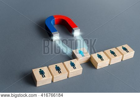 Magnet Pulls A Person Out Of Row Blocks. Choosing Best Candidate For Hiring. Competition For A Worki