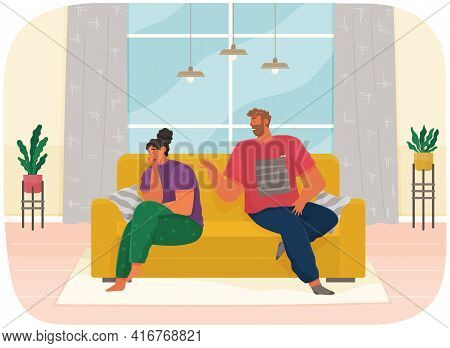 Young Couple Sitting On Couch Quarreling At Home. Angry Man And Woman Couple In Bad Relationship