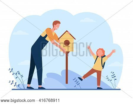 Father And Son Putting Birdhouse Outside. Adult And Child Sharing Carpentry Hobby, Caring About Bird