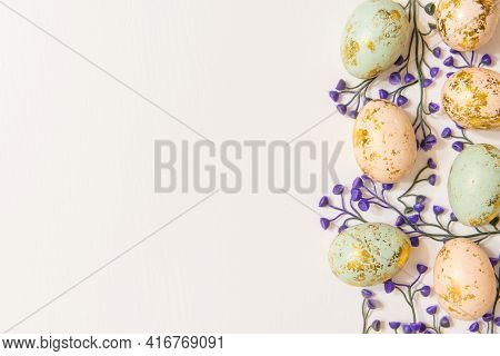 Colorful Easter Eggs With Spring Blossom Flowers Isolated On White Background And Copy Space On Left