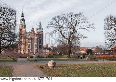 Copenhagen, Denmark - December 9, 2017: Rosenborg Castle And Bare Tree In Park On A Winter Day