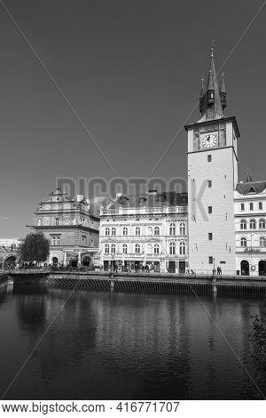 Prague, Czech Republic - April 30, 2017: Old Prague View, Black And White Photo, Tourists Walk Near
