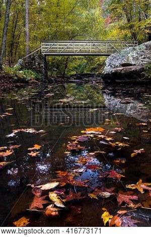 Fall Colors At Petit Jean State Park In A Mountain Stream With A Bridge Crossing