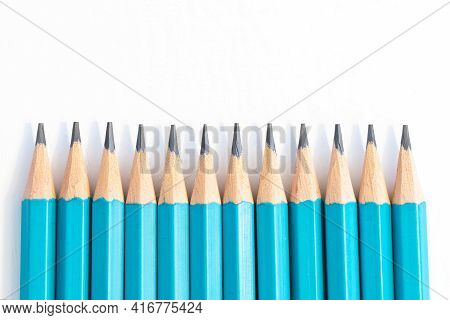 Close Up Blue Pencils Isolated On White Background With Copy Space On Top. Back To School Concept