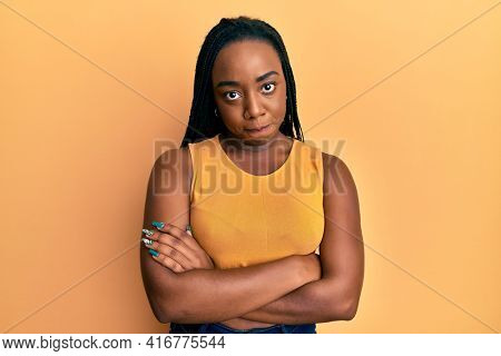 Young african american woman with arms crossed gesture skeptic and nervous, frowning upset because of problem. negative person.