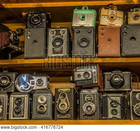 Clarkrange, Tennessee Usa - April 08, 2021  A Collection Of Old Antique Vintage Film Cameras Of Diff