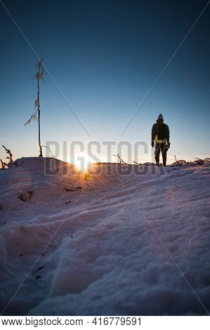 Sunrise In Winter In The Beskydy Mountains In Eastern Bohemia. A Teenager In A Colorful Jacket Stand
