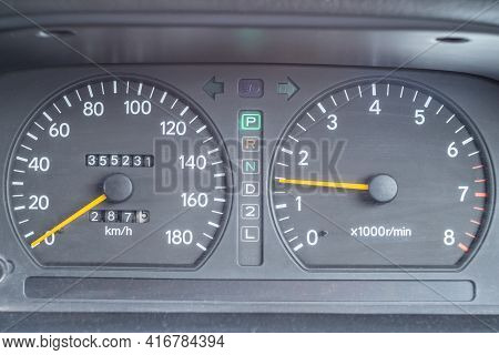 An Old Analog Dashboard Of A Japanese Car. Close-up Speedometer Up To 180 Km And Tachometer Up To 80
