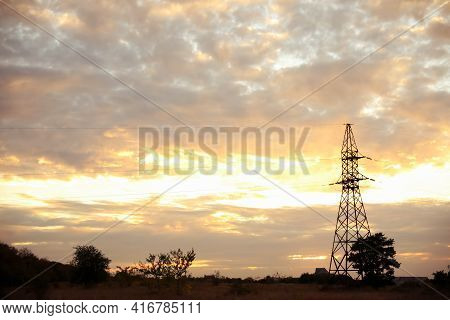 Picturesque View Of Landscape With Transmission Tower And Beautiful Cloudy Sky