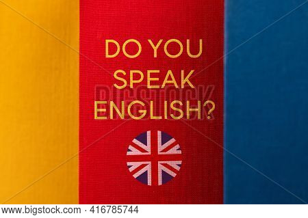 World English Language Day. The Book Covers Are Close Together. The Text On The Book, You Speak Engl