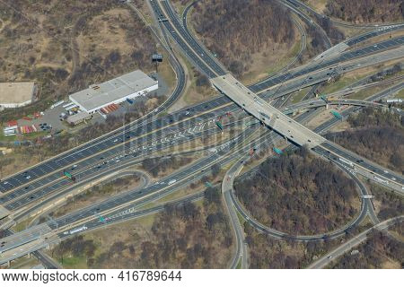 High Drone View Above Highways, Interchanges The Roads On Interstate Takes You On A Fast Transportat