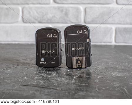 Russia, Krasnodar - April 2, 2021: Triopo G4 Wireless Flash Synchronizers Stand On A Black Backgroun