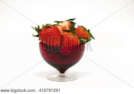 Appetizing Strawberry In A Red Bowl Isolated On White Background