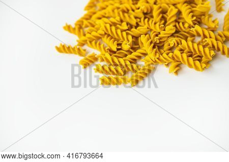 Fusilli Pasta Close-up On A White Plate. Natural Pasta Made From Hard Wheat With The Addition Of Pum