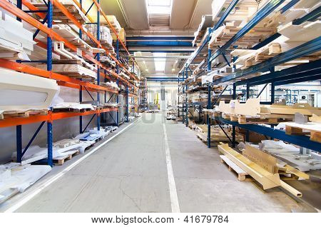 Modern Warehouse With Symetric Rows Of Shelves Interior