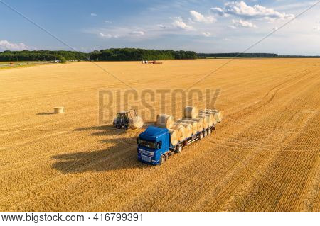 Aerial View Of Truck With Hay Bales. Agricultural Machinery