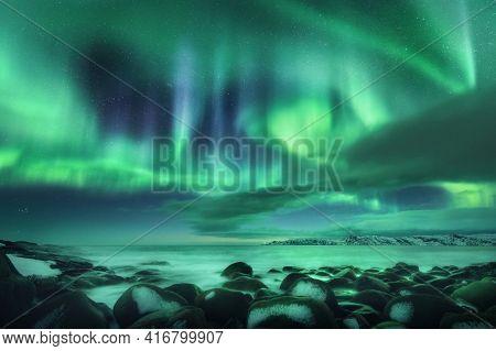 Aurora Borealis Over Ocean. Northern Lights In Teriberka