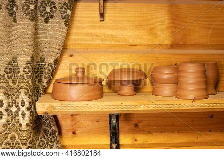 Handmade Earthenware On A Shelf In A Store. Pot, Bowl, Plate, Clay Mug