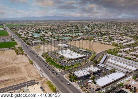 Aerial Overlooking Desert Small Town A Avondale City Of Beautiful Highway Arizona On The Mountain Wi
