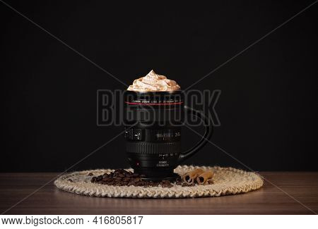 A Mug Of Frappuccino Coffee In The Image Of A Canon Lens.