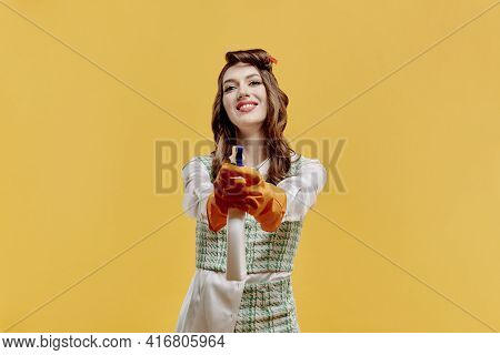 A Cleaning Lady Holds A Window Cleaner Spray In Her Hand. Hands In Latex Gloves.