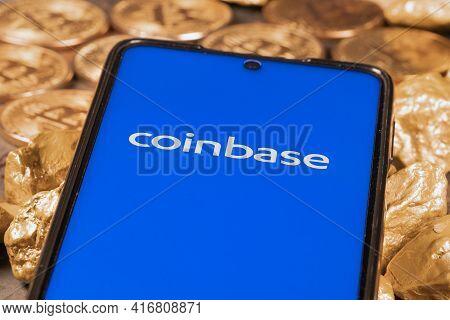 Coinbase Crypto Exchange Logo On Screen With Bitcoin Coins. Ljubljana, Slovenia - April 12 2021