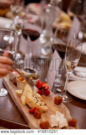 Cheese Plate. Delicious Cheese Mix With Walnuts, Honey On Wooden Table. Tasting Dish On A Wooden Pla