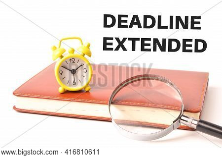 Clock, Magnifying Glass And Notebook Written With Deadline Extended. Business And Education Concept.