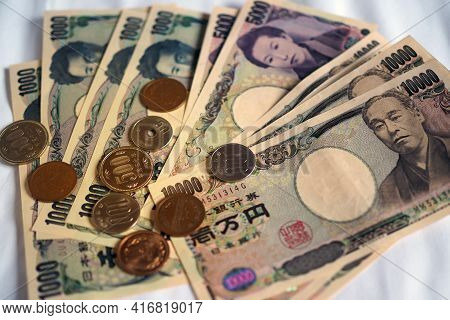 Japanese Yen Notes And Japanese Yen Coins For Money Concept Background.