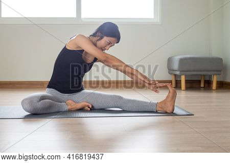 Asian Women Stretching Exercises For Good Health While Under House Arrest Doing Yoga For Relaxation,