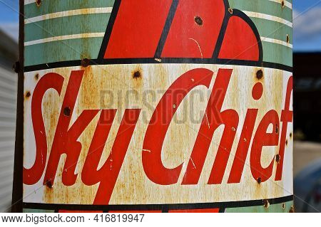 Ulen, Minnesota, April 9, 2021:the Old Gasoline Pump Advertises Sky Chief Gasoline Introduced By Tex