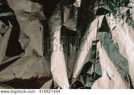 Crumpled Foil Texture. Crumpled Paper Is Shiny With A Color Tint.