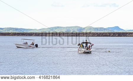 Mackay, Queensland, Australia - April 2021: Two Boats With Families Floating Near Dam Wall For Some