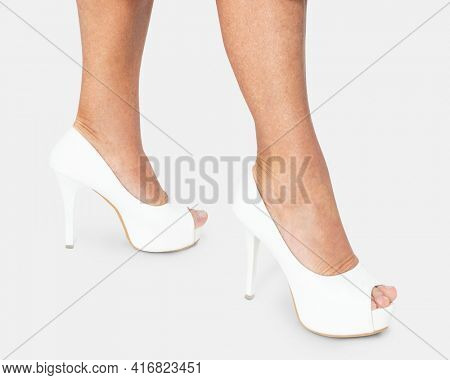 Women's white platform heels for business apparel shoot with design space