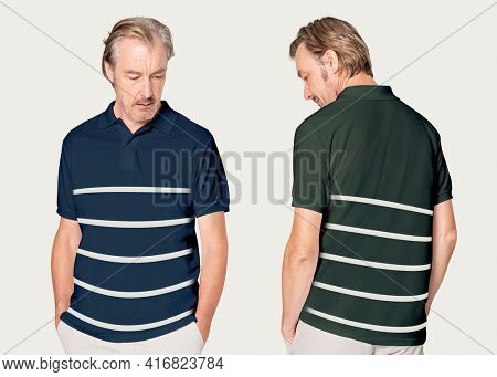 Mature man in navy and green polo shirt with stripes studio shoot