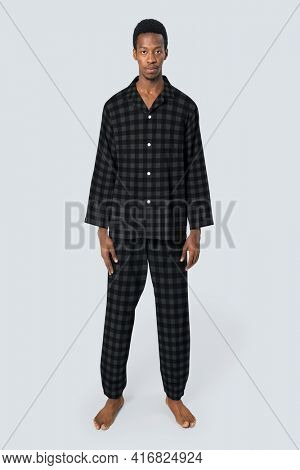 Man in black plaid pajamas sleepwear apparel full body