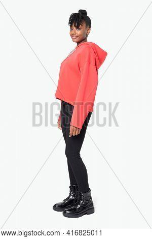 Sporty woman in red hoodie streetwear apparel full body